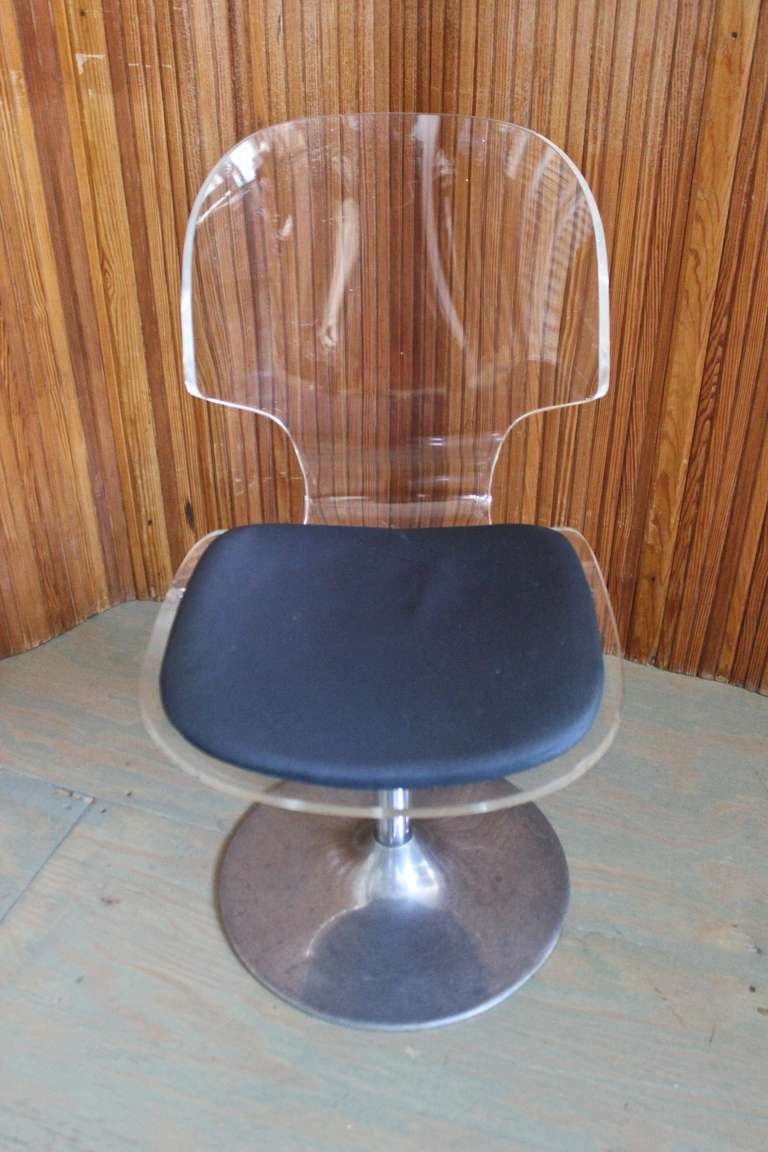 Pair of Lucite and chromes swivel side chairs, possibly, American, 1970s.   Measures: 32.5