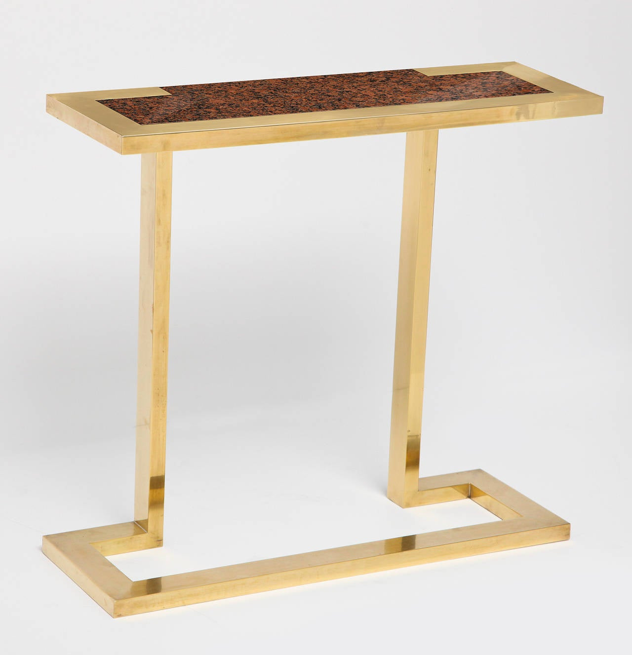 Freestanding console in brass with a granite top by Nucci Valsecchi.