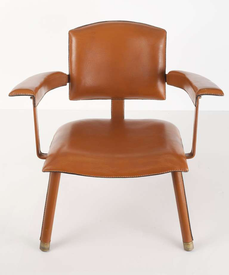 Rare armchair by Jacques Adnet in leather and metal.
