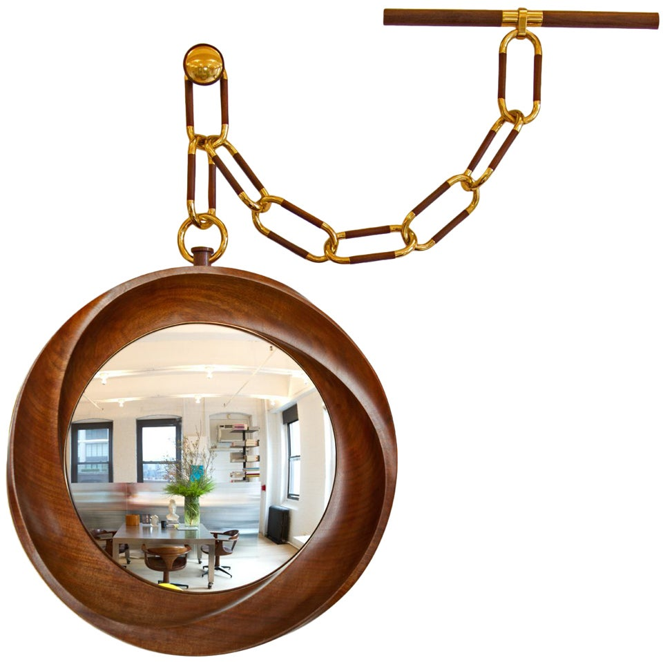 """""""Montre a` Gousset""""  Convex mirror with a walnut frame.  With chain: Height 30"""", width 30.5""""."""