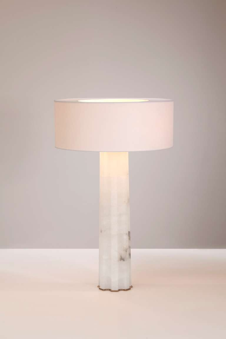 Alabaster table lamp with patinated gilt bronze accents and a paper lampshade, by Hervé van der Straeten  Monogrammed: HV