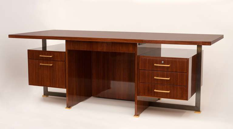 A rare desk with conference table extension by Maison Leleu in mahogany with patinated and gilt bronze legs