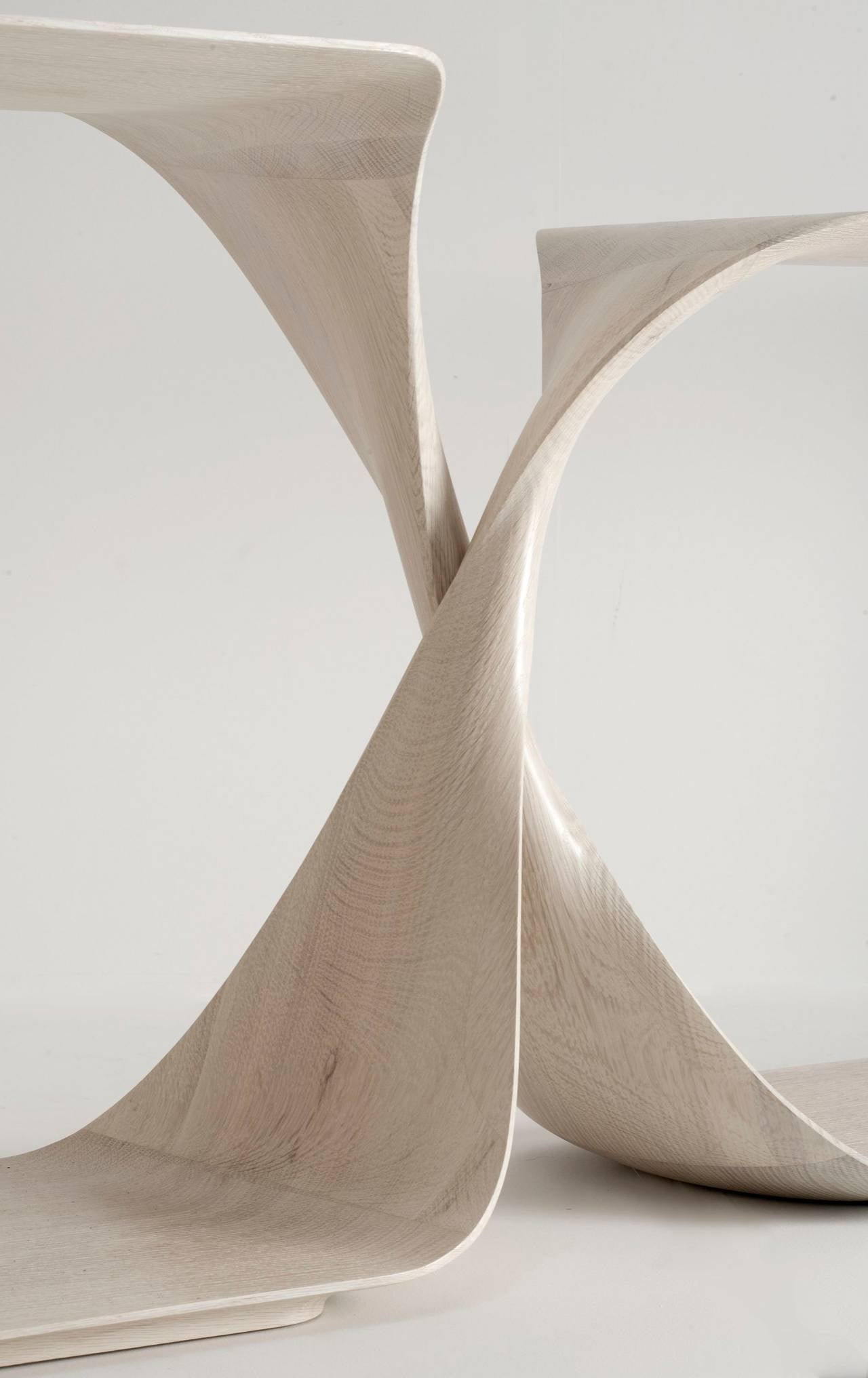 Contemporary freestanding sculptural console in hand-carved limed oak by Carol Egan.