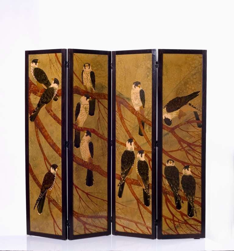 A fine and rare four-panel lacquered screen depicting falcons by André Ducaroy  Signed and dated: