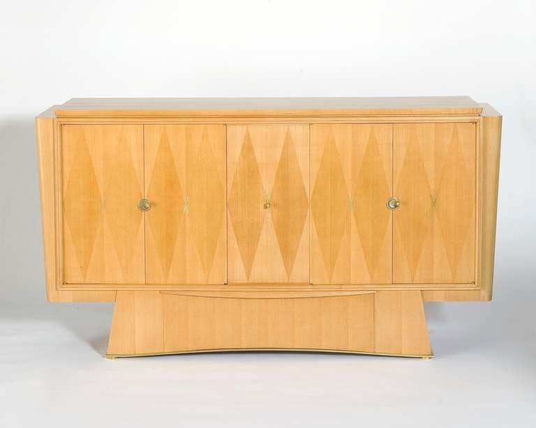 Five-door pale oak cabinet with geometric patterned inlay in the manner of Dominique.