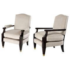 Jean Pascaud, Two ebonized wood armchairs, France, c. 1949