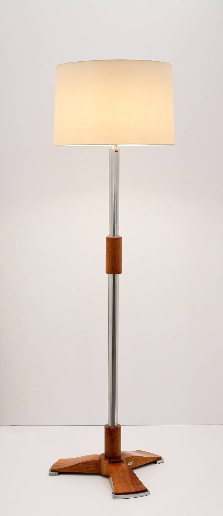Art Deco floor lamp in French walnut and chromed metal by Jules Leleu.  Signed on base: J. Leleu.  An identical floor lamp was exhibited in the two museum retrospectives on Leleu: Leleu 50 ans de mobilier et de décoration, 1920-1970 at the Musée des