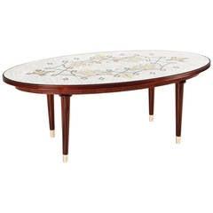 Jules Leleu, Mahogany coffee table with eglomisé glass top, France, c. 1948