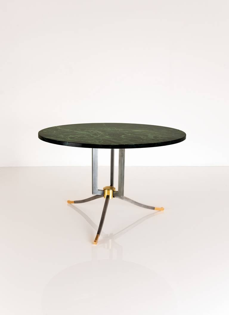 Rare steel and gilt-bronze coffee table by Jules Leleu with its original green marble.    Numbered: 5065  Bibliography: Illustrated in Leleu Décorateurs Ensembliers by F.Siriex, Editions Monelle Hayot, p. 413