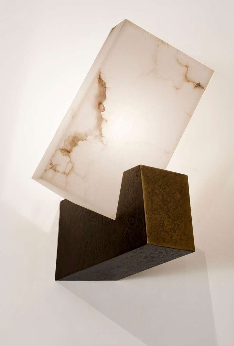 Contemporary patinated bronze and alabaster sconce.  Please note, price is per sconce.