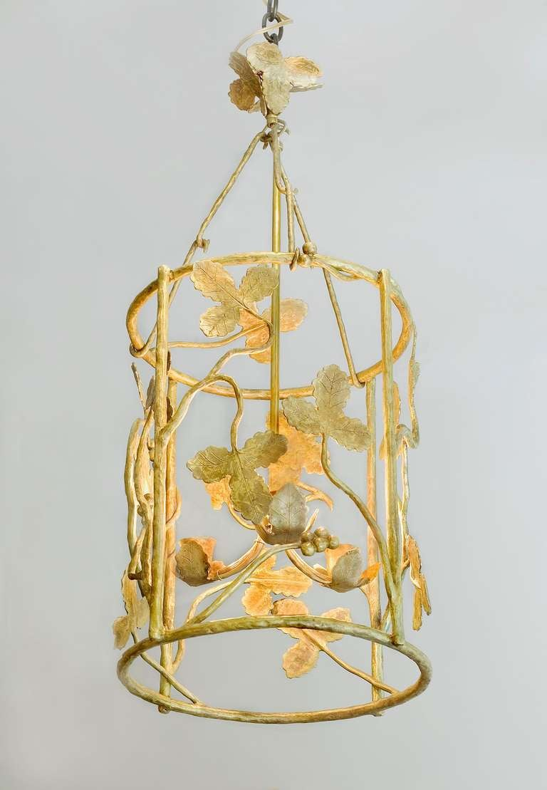 Contemporary polished bronze lantern by Marc Bankowsky.  Overall drop / Height: 27'' Diameter of cylinder:  13'' Height of cage (cylinder): 16'' Height of canopy: 5.25'' Width of canopy: 3.75'' Bulb: Three candelabra bulbs Wattage: 60 each (maximum)