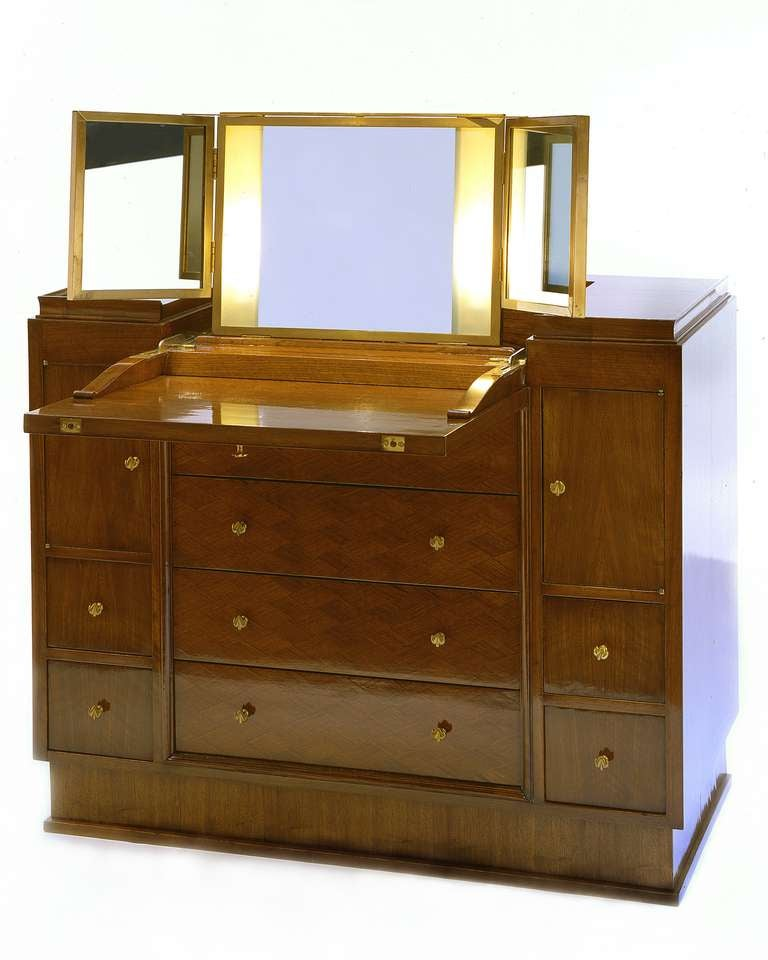Rare palissander drop front vanity cabinet by Jules Leleu (1883-1961). The drop front opens to reveal an illuminated mirror in three sections