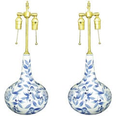 Pair of elegant long neck vases with lamp application.