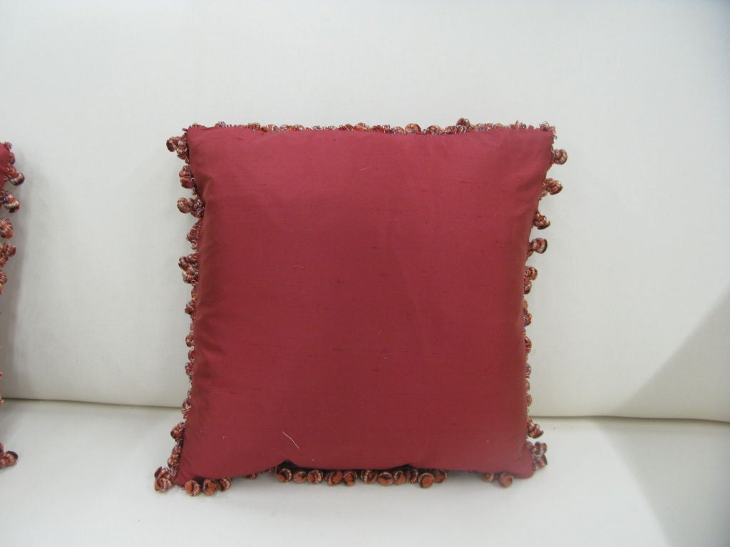 Red silk throw pillows with decorative Ball Fringe at 1stdibs