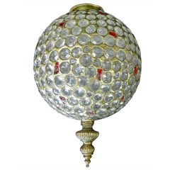 Large faceted crystal and red glass globe