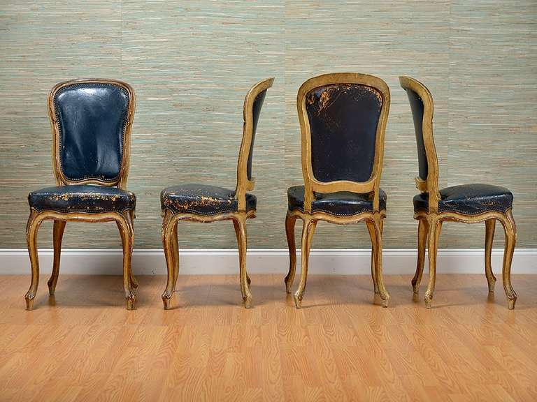 vintage set of eight navy leather dining chairs at