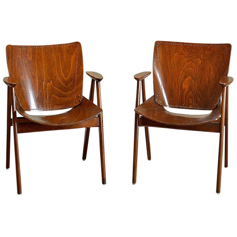 Pair of antique punched wood arm chairs at stdibs