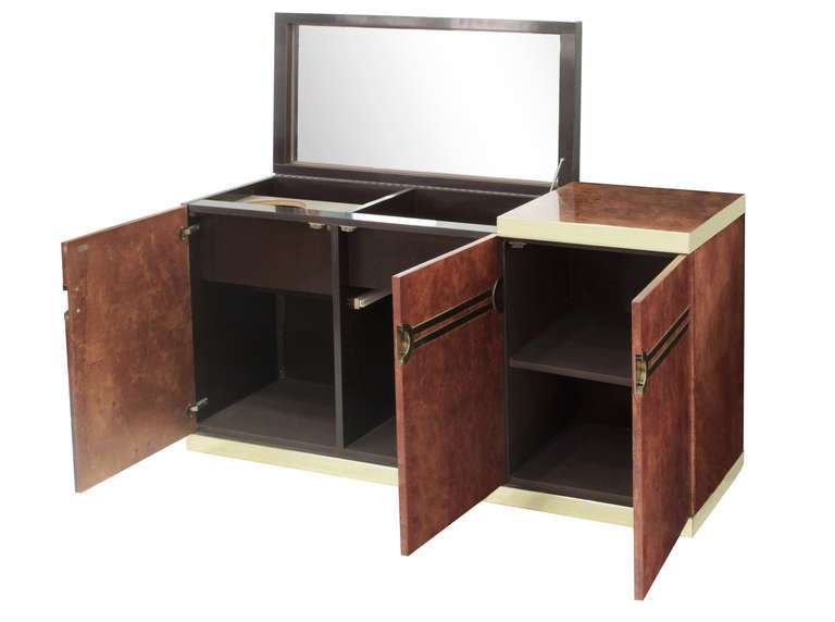 Lift-top bar unit in burled olive wood with brass banding and pulls by Pierre Cardin, American, 1970s (signed