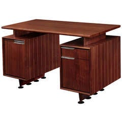 Rare Desk in Walnut with Lucite Pulls by Gilbert Rohde