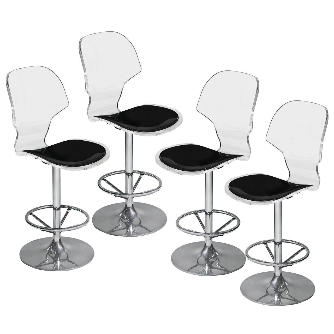 This Set of 4 Counter Height Swiveling Bar Stools in Molded Lucite is ...