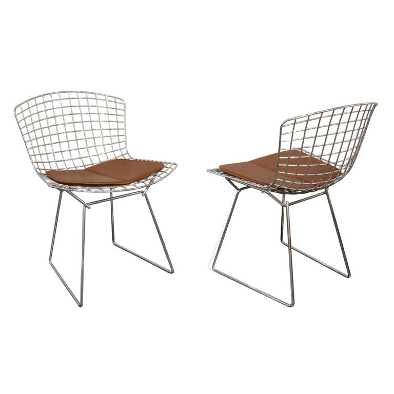 this set of 10 dining chairs with custom seat pads by harry bertoia is