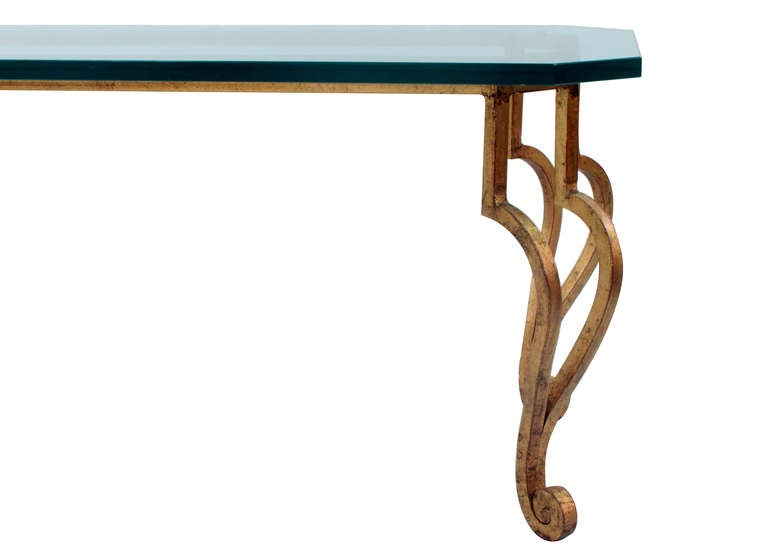 Rectangular coffee table in gilded bronze and scroll legs with thick glass top, French, 1950s.