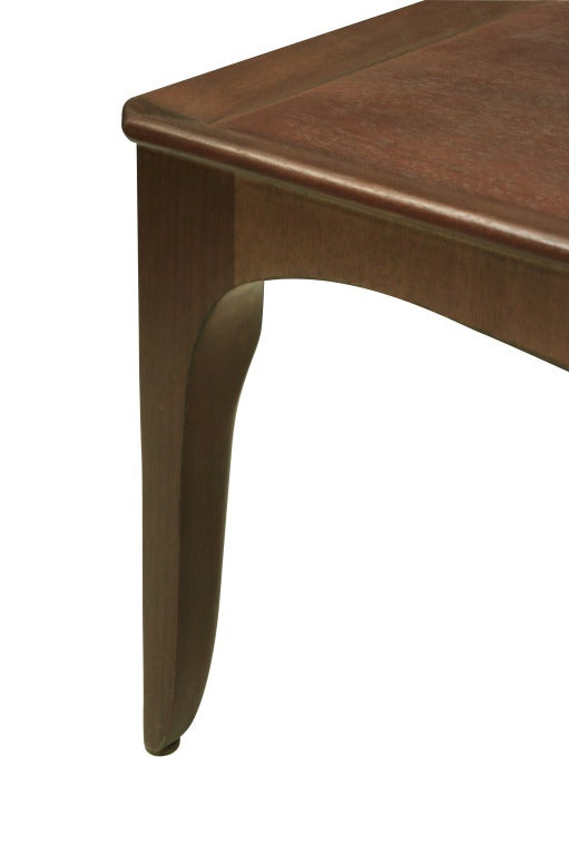 Coffee table in mahogany with curved edge design by Edward Wormley for Dunbar, American, 1940s (retains early metal Dunbar tag on bottom).