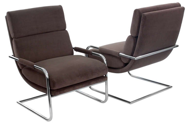 Pair of cantilevered lounge chairs with tubular chrome frames and upholstered seats, backs and armrests by Milo Baughman for Thayer Coggin, American 1970s. These are newly upholstered by Lobel Modern.