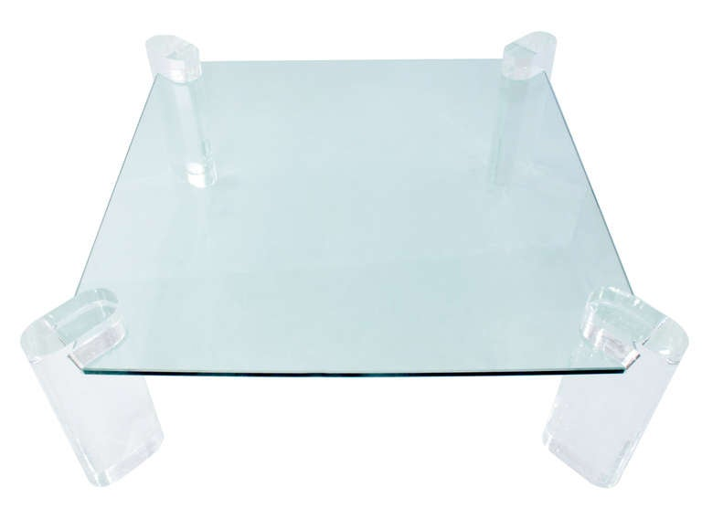 """Lucite leg coffee table with thick glass top by Karl Springer, American, 1980s (signed on leg """"Karl Springer"""")."""