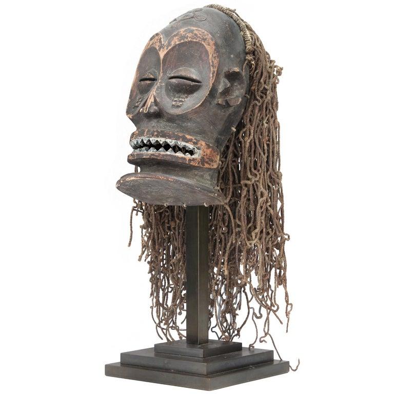 Hand-Carved African Mask on Bronze Base by Karl Springer For Sale