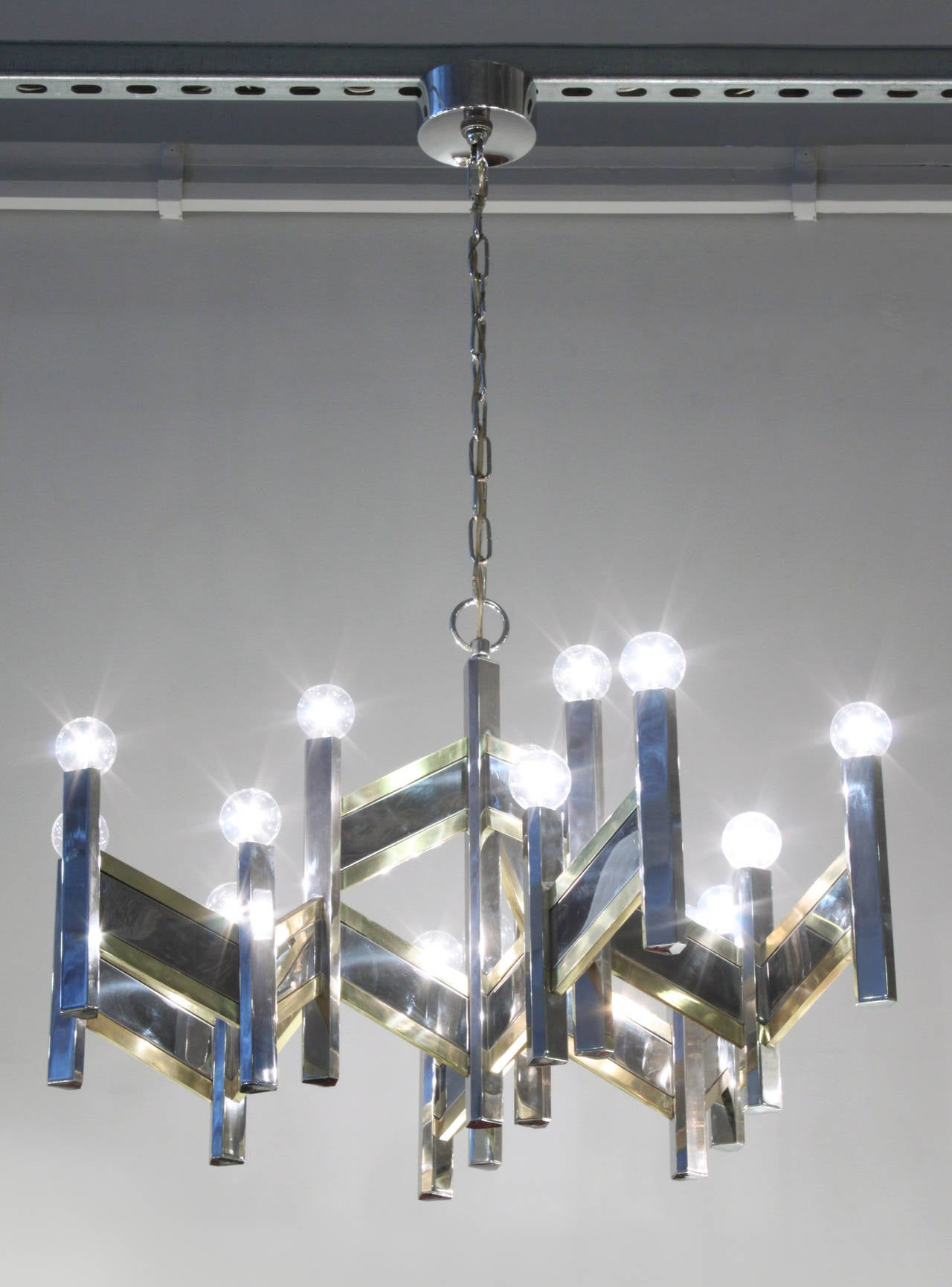 Elegant Chandelier in Chrome and Brass Accents by Sciolari For Sale 1