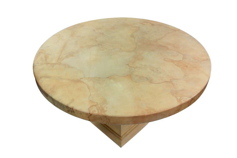 "Round table with top covered in lacquered goatskin designed by Karl Springer, American, 1977 (original label on bottom reads ""Karl Springer 1977"")."