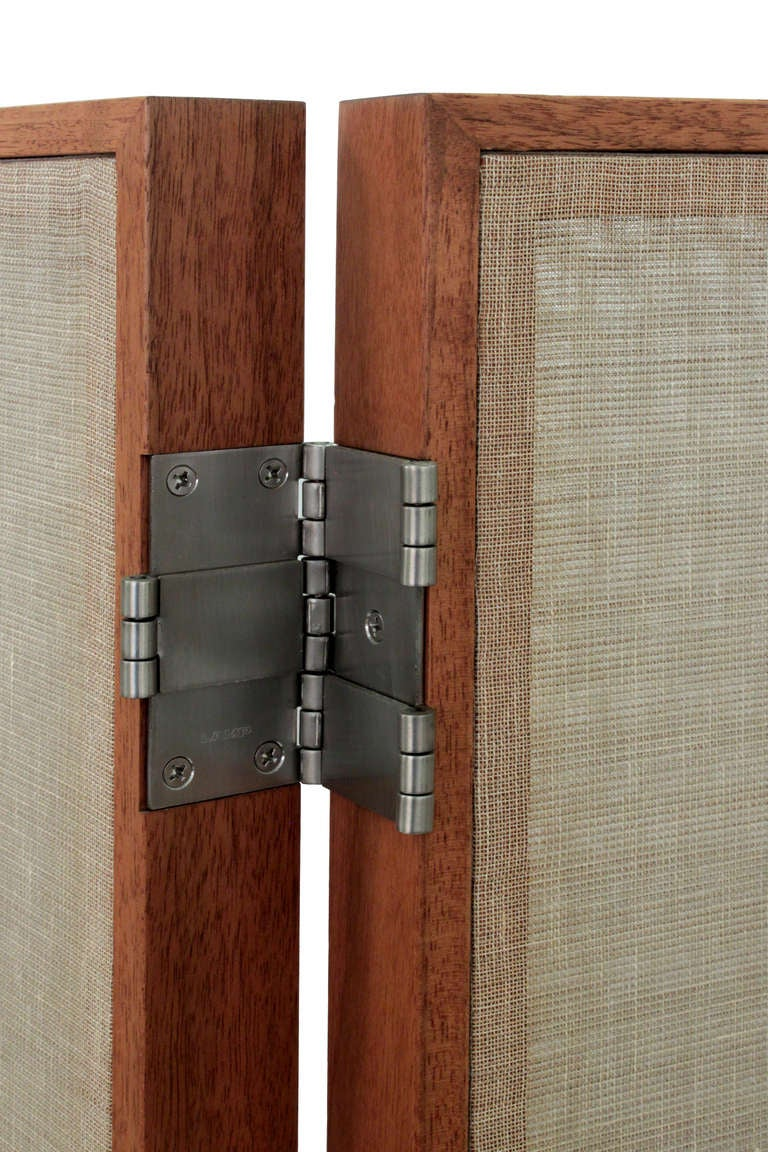 Screen in walnut with inset sheer linen panels and custom hardware by Thad Hayes, American 1990s.  Dimensions: (as shown) 84 inches wide. 16 inches deep. 60 1/2 inches high.