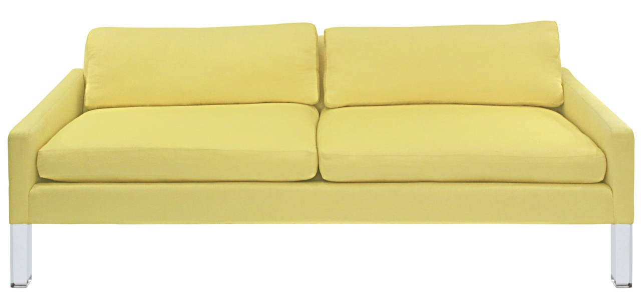 Chic clean line sofa with solid Lucite legs, American 1970s.