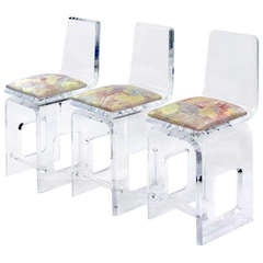 Set of Three Thick Molded and Beveled Swiveling Lucite Bar Stools