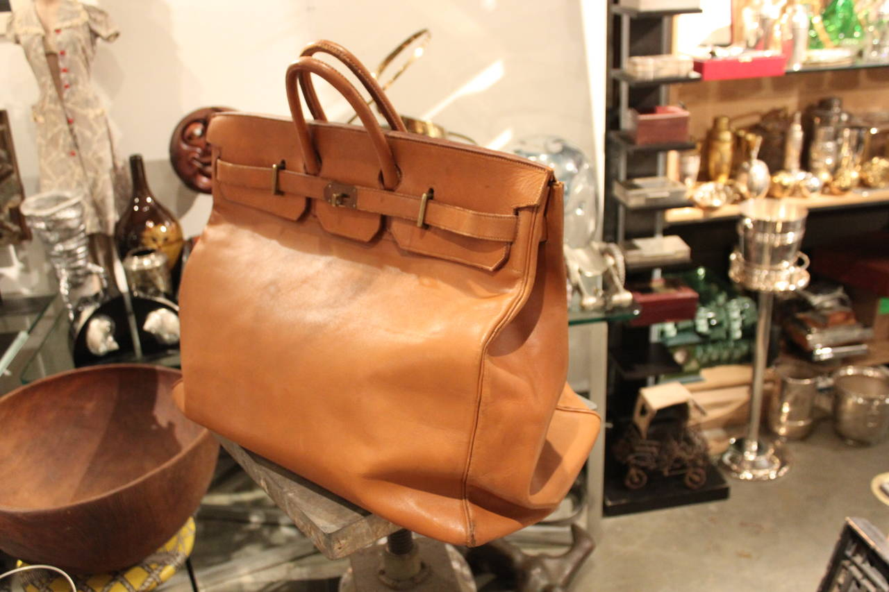 Amazing Hermes 55 cm HAC bag. This bag has perfect wear. It is structurally very strong. A great vintage example.