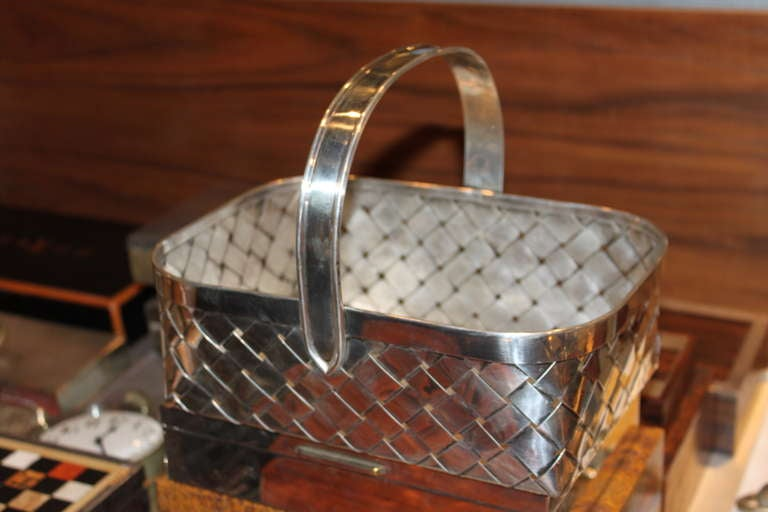 This is the largest size basket Cartier made in sterling. The basket is all handwoven.