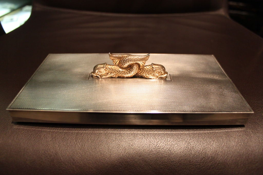 We love this box. Engine turned silvered bronze and brass serpents. A beautiful piece.