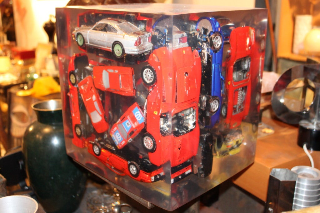 Incredible Lucite cube with Ferraris embedded in it. We love things in Lucite, but we had to buy this thing.