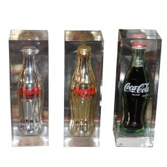 Collection of Coke bottles in Lucite