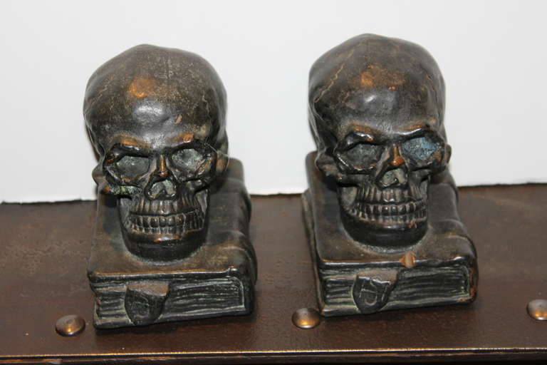 These wonderful bookends are made by Armor Bronze out of NY. The material is actually heavy bronze clad over cement making these about 7 lbs. These came in polychrome color, brown patina as well as this blackish green patina.