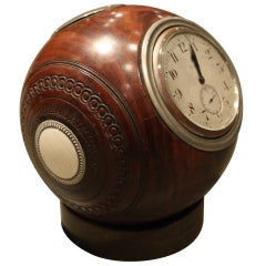 An Unusual Lignum wood and silver Trophy Lawn Ball Form Ball 8 day Clock