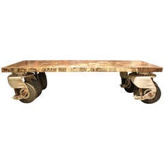 Amazing and Unique Coffee Table Fabricate from Giant Industrial Wheels