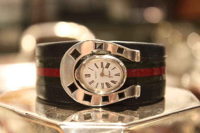 97222623415 This is an extremely rare example of a 1970 s Gucci watch. The Horseshoe  form case