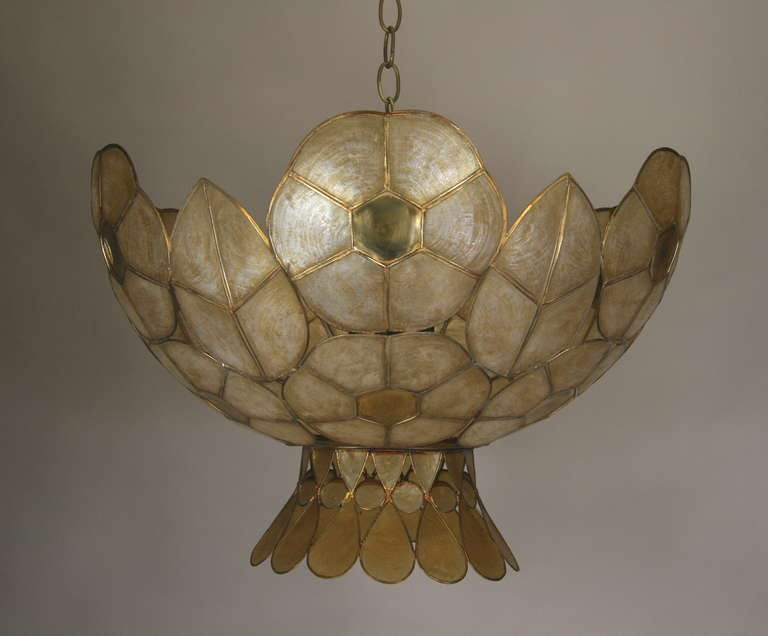 1-2891  A 1940s three-light large capiz shell pendant in a light amber color Takes 3 60 watt bulbs