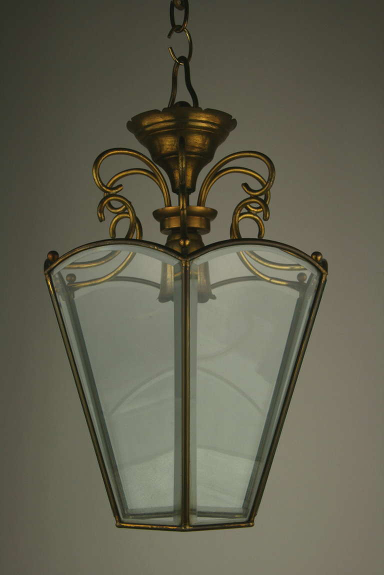 #1-2955, a scrolled brass top six bevelded glass panel Italian lantern.