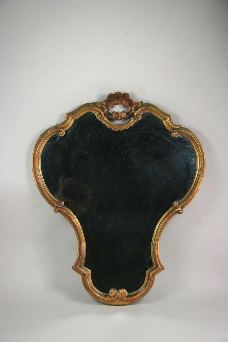 #6-2 A gilded carved wood venetian mirror.