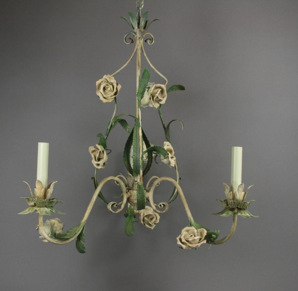 #1-2359 a three-light tole and porcelain hand-painted chandelier.  On sale regular price $1475 now $800 net. No additional discounts.