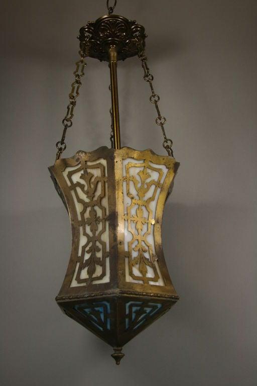 #1-2581, a 1930s Arts and Craft pierced brass and slag glass fixture. One internal light 100 watt max.
