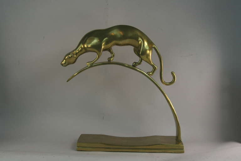 #9-061 A solid polished brass panther sculpture. No makers mark.
